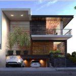 casa a due paini con garage e rivestimento in pietra